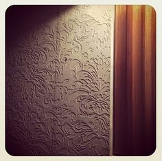 'Tir Na Nog' home by Drew Heath Architects was the Wilkinson Award winner at the NSW Architecture Awards. These wallpaper impressions on concrete appear in one of the multiple bathrooms in the house.