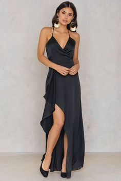 Sleek, chic and totally on fleek! The Slip Maxi Dress by Passion Fusion comes in black and features a wrap front, thin adjustable shoulder straps, a hidden zipper at back and a slit at front. Style with high heels and your favorite jewelry for complete look!