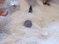 Fake snow sensory play, fill an infant water table with fake snow!!