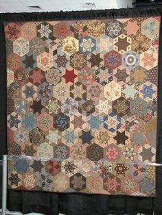 Hexagon stars with a vintage feel.  2011 Quilt Market.  Photo by Jackie-Quilts!, via Flickr