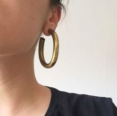 These Are Instagram's Favorite Hoops #refinery29  http://www.refinery29.com/laura-lombardi-hoop-earrings-instagram#slide-1  From this angle, you can see they're hollow.Laura Lombardi Curve Earrings, $98, available at Laura Lombardi....