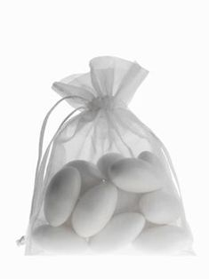 ITALIAN WEDDINGS Five almonds signify five wishes for the bride and groom: health, wealth, happiness, fertility, and longevity. These almonds decorate each place setting as favors, tucked into pretty boxes or tulle bags called *bomboniere*