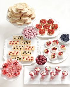 Take advantage of summer's bounty with a berry dessert bar featuring raspberry cream cookies, chocolate strawberry candies, strawberry-pistachio tarts, fruit-topped pavlovas and berry financiers
