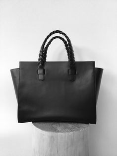 Black calfskin tote with braided handles