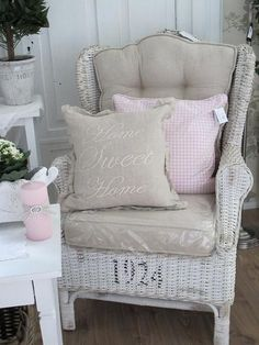 Must find an old wicker chair! Add some linen(maybe dropcloth cushions!).
