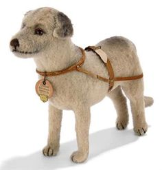 A STEIFF STANDING CHINOOK BYRD'S ARTIC EXPEDITION DOG, light brown wool plush with black shading, brown and black glass eyes, brown stitching, leather harness with five FF buttons and chest tag, circa 1930.