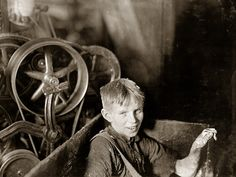 Boy in the Box: April 1909. Anthony, Rhode Island. One of the young spinners in the Quidwick Co. Mill. A Polish boy, Willie, who was taking his noon rest in a doffer-box. Photograph and caption by Lewis Wickes Hine.