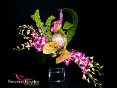 Tropical flower arrangement for Corporate, Hotels or Tropical Weddings.  Protea, anthuriums and dendrobium orchids with woven palms help complete the tropical feel. Designed by Naples, FL Event Planner and Florist, Steven Bowles Creative www.stevenbowlescreative.com