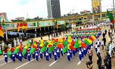 Cameroon National Day include parades, public officals dressed in commemorative clothing, school children dancing, and various cultural activities.