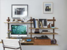 "Desk from DWR. ""A combination desk and bookshelf saves space."""