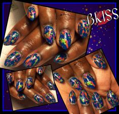 Paint splattered design that I love so much on baby oval nails.  Navy blue with a variety of colors to make this set something spectacular.
