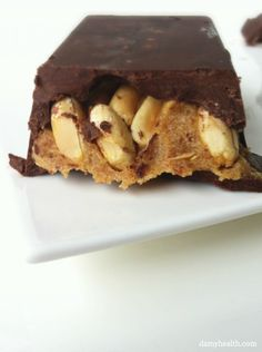 Raw Homemade Snickers Bar *This recipe is gluten free, vegan, raw, dairy free and the perfect Healthy Snicker Bar Dupe. http://www.damyhealth.com/2012/10/raw-homemade-snickers-bar/
