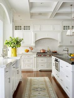 This Kitchen Is Spacious, Light, And Airy With Its All White Color Palette.  Custom Cabinetry, Carrara Marble Counters And A Coffered Ceiling Set A ...