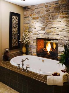 Install a two-sided fireplace between the bathroom and the bedroom. Who needs heated tiles when you have a bathroom fireplace? Dream Bathrooms, Beautiful Bathrooms, Master Bathrooms, Luxury Bathrooms, Master Baths, Romantic Bathrooms, Marble Bathrooms, Bathroom Mirrors, Bathroom Cabinets