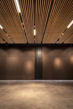 Our lighting at the House of Louis Roederer champagne in Reims, France. Picture by Sophie Scher - Design by Jean Philippe Thomas Architectes. Wood Slat Ceiling, Baffle Ceiling, Wooden Ceilings, Wood Slats, Tv Wall Design, Ceiling Design, Roederer Champagne, Office Ceiling, Showroom Interior Design