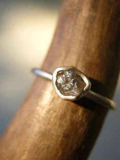 This rough diamond engagement ring. | 65 Impossibly Beautiful Alternative Engagement Rings You'll Want To Say Yes To