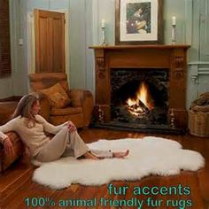 Fantasy set-up! Romantic fireplace and a white bearskin rug...upon ...