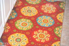 DIY rug made from fabric and vinyl - so easy!! It's fabric spray glued to vinyl flooring, coated with polyurethane.