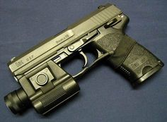 9mm Heckler and Koch Pistol USP with Flash light accessories