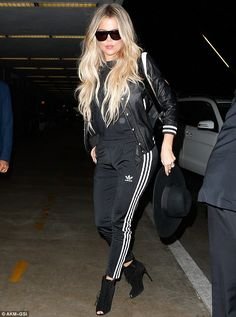 Khloe Kardashian gets patted down by security as she jets ou.- Khloe Kardashian gets patted down by security as she jets out of LA Collegiate style: The natural beauty was wearing a trendy varsity jacket - Khloe Kardashian Outfits, Koko Kardashian, Sporty Outfits, Chic Outfits, Fashion Outfits, Style Fashion, Looks Adidas, Adidas Mode, Adidas Outfit