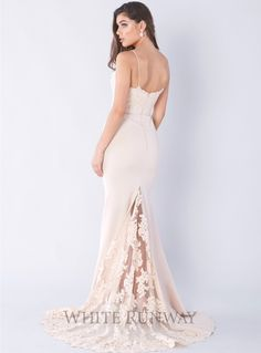 Felicie Gown. A gorgeous full length gown by Jadore. Features a sweetheart neckline with lace bodice. Comes with a floor sweeping traing with lace applique on the back.