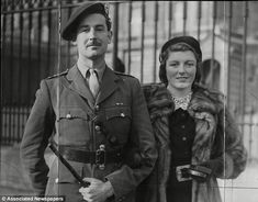 Commando leader Lord Lovat leaving Buckingham Palace with Lady Lovat after receiving D.S.O. from the King
