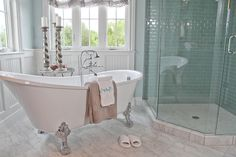 House of Turquoise. Beautiful bathroom. I love the silver claw foot tub with silver and the monogram towel