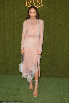 What an incredible look:Ashley Madekwe cut a stylish figure in her sheer pink and white dress with a Chanel clutch - the 8th Annual Veuve Clicquot Polo Classic - October 14 2017