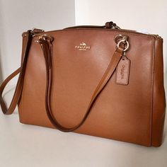 """HPNWT Coach Christie light brown tote bag Coach leather bag. Light brown, gold hardware. Has handles and 9"""" crossbody strap. L15""""D4 3/4""""H10"""". Coach Bags Totes"""