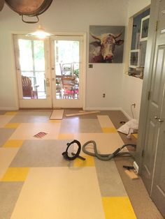 Our marmoleum by Forbo floors are clicking right into place!