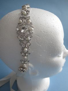 This beautiful comfy ivory ribbon Pearl Rhinestone headband is a great alternative to a veil, tiara or wear it for your reception! The crystal