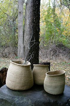 a trio of rustic baskets
