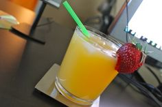 Morning mock tail: grapefruit and tangerine juice with a strawberry from Trader Joe's