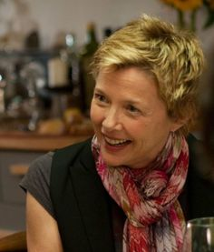 Annette Bening. Love the simple black T and the beautifully tied scarf.