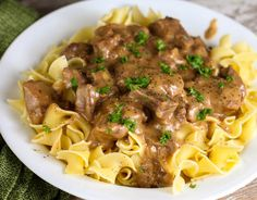 Company Beef is an easy stew beef recipe that uses 5 ingredients and is made with ginger ale and onion soup packet and tastes great served over egg noodles. Stew Meat Recipes, Beef Stew Meat, Slow Cooker Beef, Oven Recipes, Noodle Recipes, Asian Recipes, Easy Ground Beef Stroganoff, Ground Beef Recipes Easy