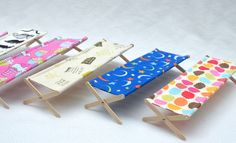 ikat bag: Cots for 12-inch dolls. Made with 4 popsicle sticks, 2 dowels, hardware and fabric.