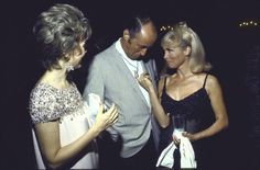 Janet Leigh cozies up to musician Henry Mancini at a cocktail party at Paradise Island resort, Nassau, The Bahamas. 1968. Photograph by Bill Eppridge for LIFE Magazine.