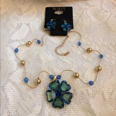 Gorgeous Blue Flower necklace earrings fr JC Penny Gorgeous Blue Flower necklace earrings from  JC Penny. Brand new and in excellent condition . Jewelry Necklaces