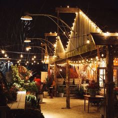 Remodeled Barn Storefront, Strings of White Bistro Lights, Lots of Greenery // via shopterrain