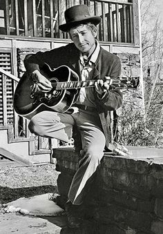 Bob Dylan Playing His Gibson J-200 Acoustic Guitar... From The Article... Dylan also owned several Gibson J-200 guitars that were played in concert. One was a gift from George Harrison. One was custom made by Gibson and it had a double pickguard. http://uniqueguitar.blogspot.com/2016/11/bob-dylans-guitars.html?m=1
