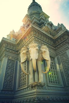 Three headed elephant sculpture on a temple in Phnom Oudong, Cambodia