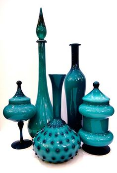 Glass, gorgeous shapes http://www.midcenturia.com/2011/06/vintage-glass-and-ceramic-store-end-of.html