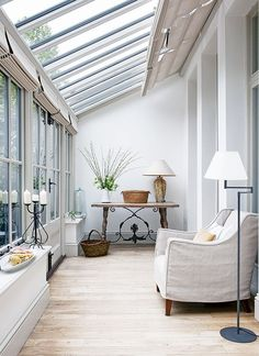 The conservatory at the back of this property gives a bright feel to the whole ground floor. London home of garden designer Lorraine Johnson. Photographs Jody Stewart. Homes & Gardens. http://www.hglivingbeautifully.com/2016/02/24/hg-house-tours-a-perfectly-formed-london-redesign/. http://www.hglivingbeautifully.com/2016/02/24/hg-house-tours-a-perfectly-formed-london-redesign/