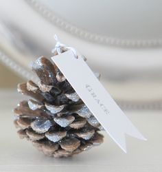 Glittered Pinecone Seating Cards / Escort Cards with Custom Sash - Collection of 8. Gold, Silver, or White. $48,00, via Etsy.