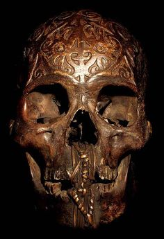 DAYAK CARVED: HEAD HUNTING HUMAN TROPHY #1 HAND CARVED HUMAN BONE THE DAYAK TRIBE, FROM BORNEO ISLAND INDONESIA, CARVE DESIGNS INTO THE SKULLS OF THEIR HEADHUNTED VICTIMS AND INSERT WOODEN FIGURES.