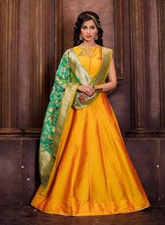 Yellow silk anarkali suit Stylized neckline with studs and embroidery Comes with a matching shantoon bottom and silk dupatta Can be stitched upto bust size 42 inches and top length 50 inches Maxi Outfits, Fashion Outfits, Silk Anarkali Suits, Anarkali Dress, Silk Dupatta, Salwar Suits, Indian Dresses, Indian Outfits, Punjabi Suits Online Shopping