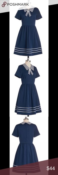Adorable Modcloth sailor dress! Size 3x Today, you fasten the hidden zipper of this navy dress, slip into peep-toe flats, and float toward the bay. The grosgrain-striped hemline of this ModCloth exclusive begins to wave in the breeze, and you grasp your red hat so it doesn't blow away. You remove your ivory cardigan, letting the striped collar of this lined, pocketed number stand out, and welcome the sky's breath. You spot a ship sailing in, and an inspired smile forms above the striped…
