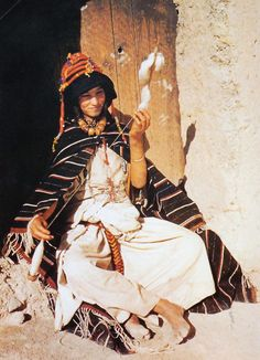 "Africa | Young Berber woman.  Imilchil, High Atlas region, Morocco || Scan from the publication ""African Textiles"" by John Picton and John Mack. Harper & Row Publishers, Inc. 1989 #berber #amazigh #tuareg #lifestyle"