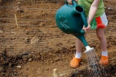 Gardening With Kids - ideas for making a kid-friendly garden and a list of things young kids can actually do in the garden to help