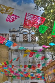 """Papel picado (""""perforated paper""""). Ooo, this is what I want to do -- crisscross the papel picado all across the ceiling!!!"""
